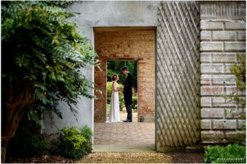 bride and groom in the orangery at ettington park hotel