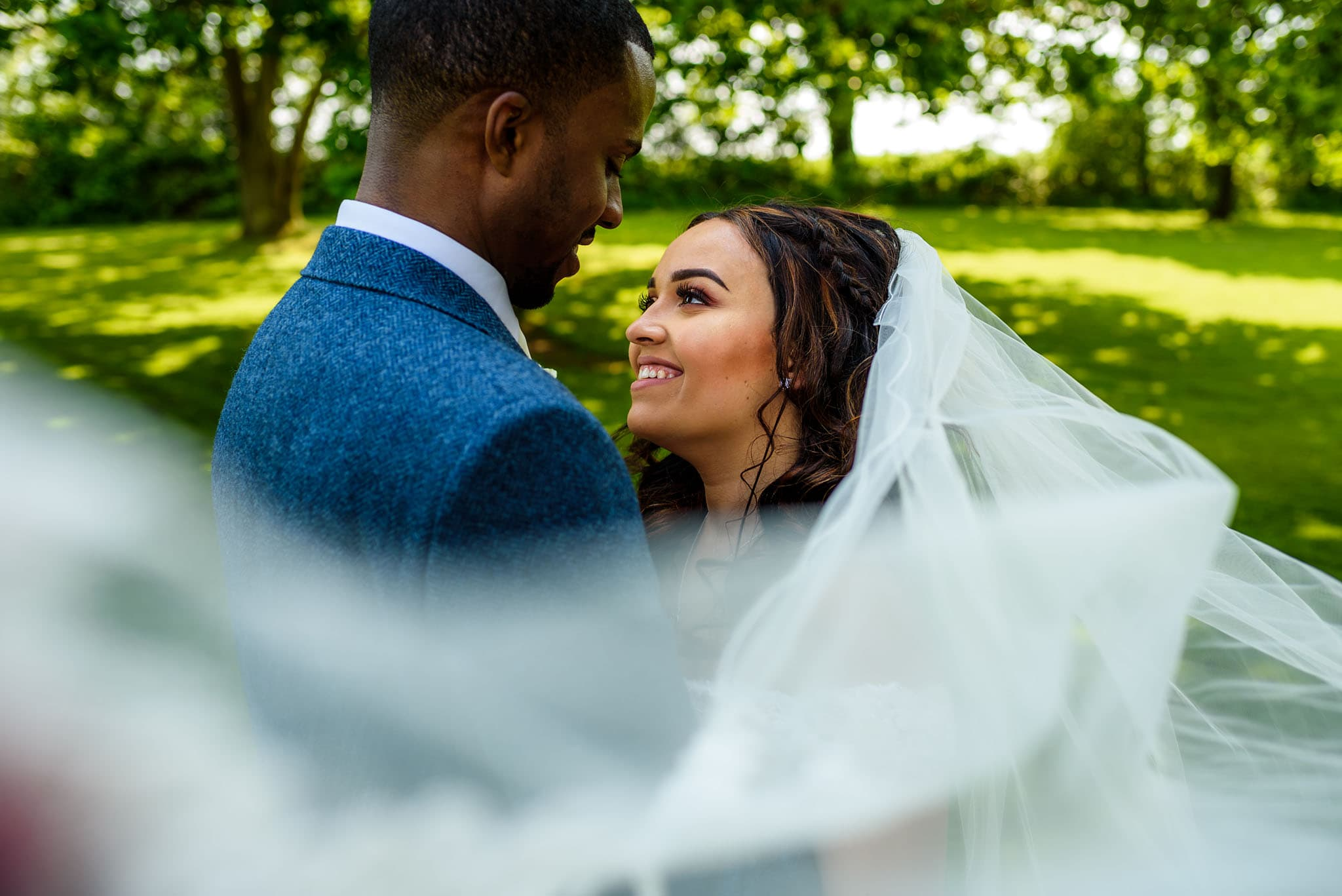 swooping veil shot of the happy couple