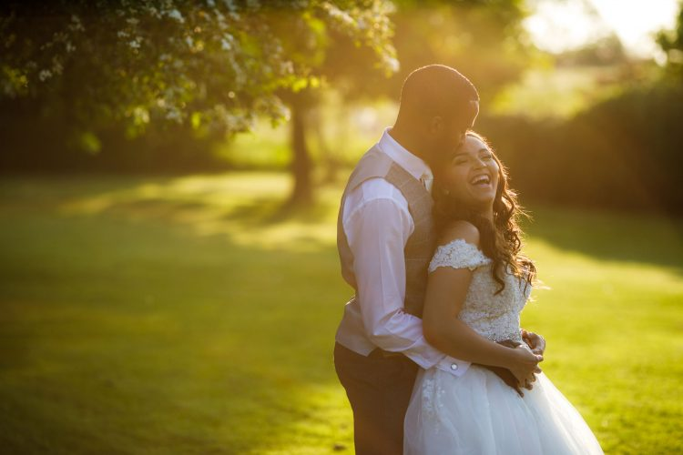 happy bride and groom portrait in the evening sunshine