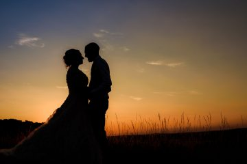sunset silhouette of the bride and groom in temple grafton
