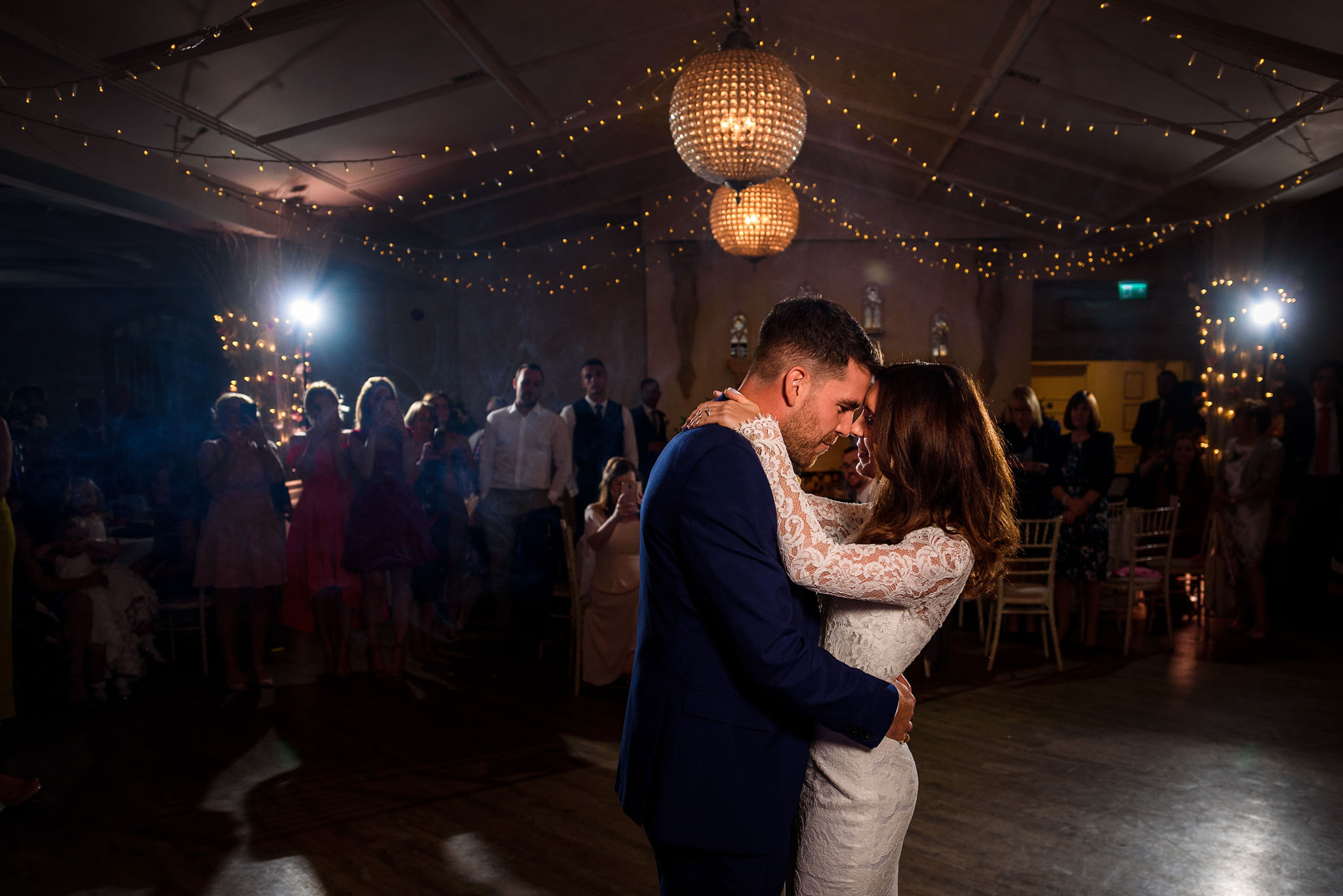 wide shot of the first dance at manor by the lake