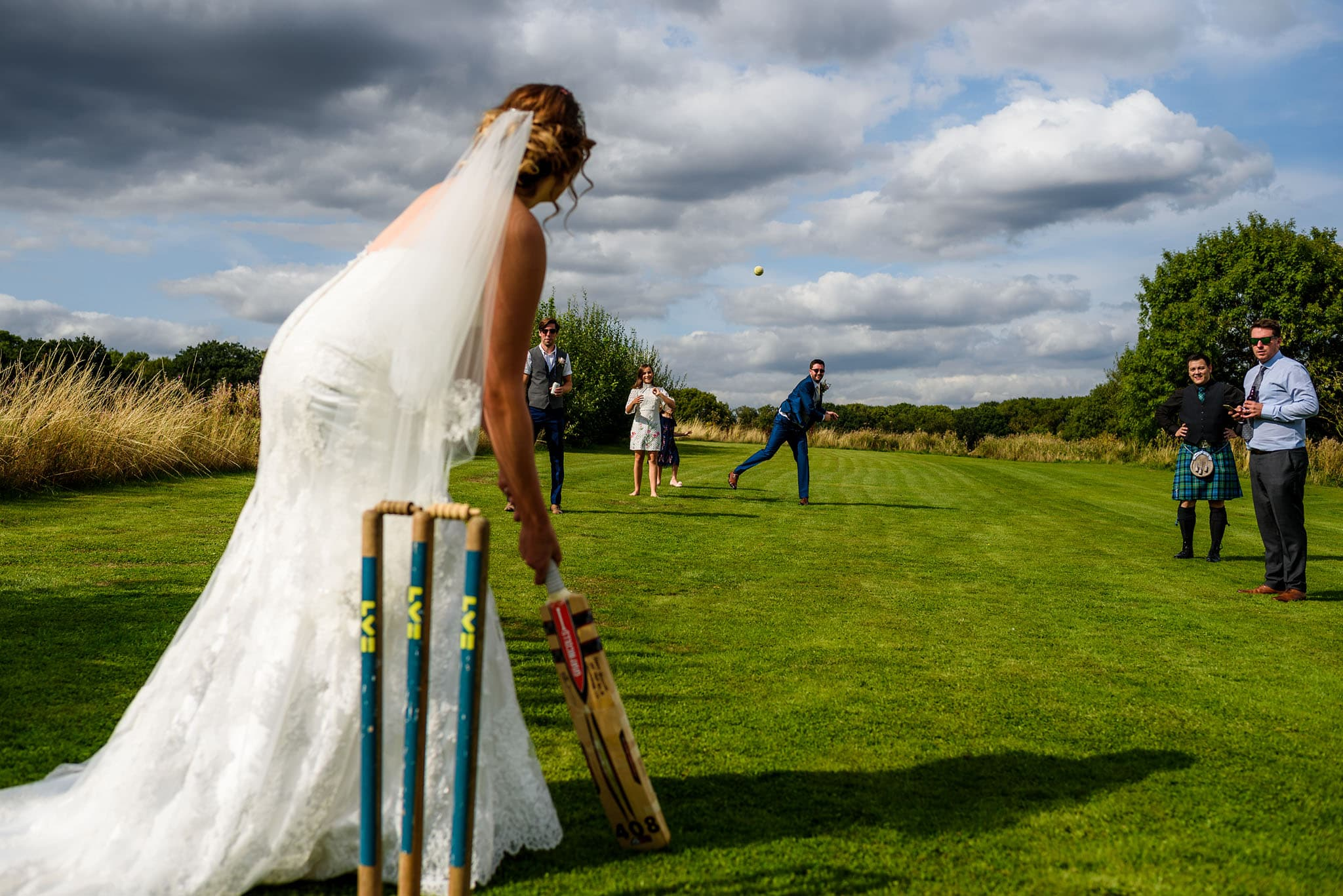 the bride and groom playing cricket at wethele manor
