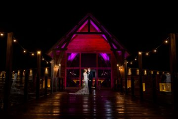 night portrait of the bride and groom outside The Mill Barns