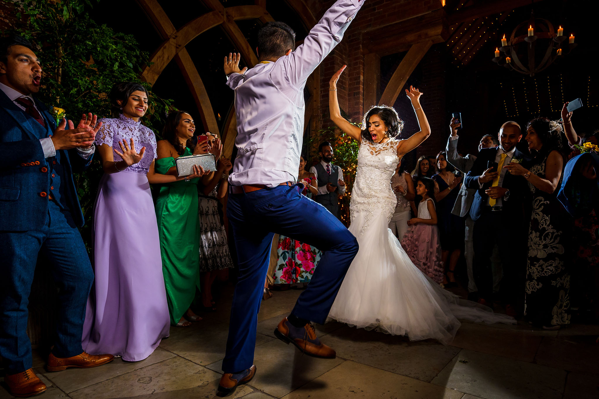 the bride and groom throwing some shapes on the dance floor