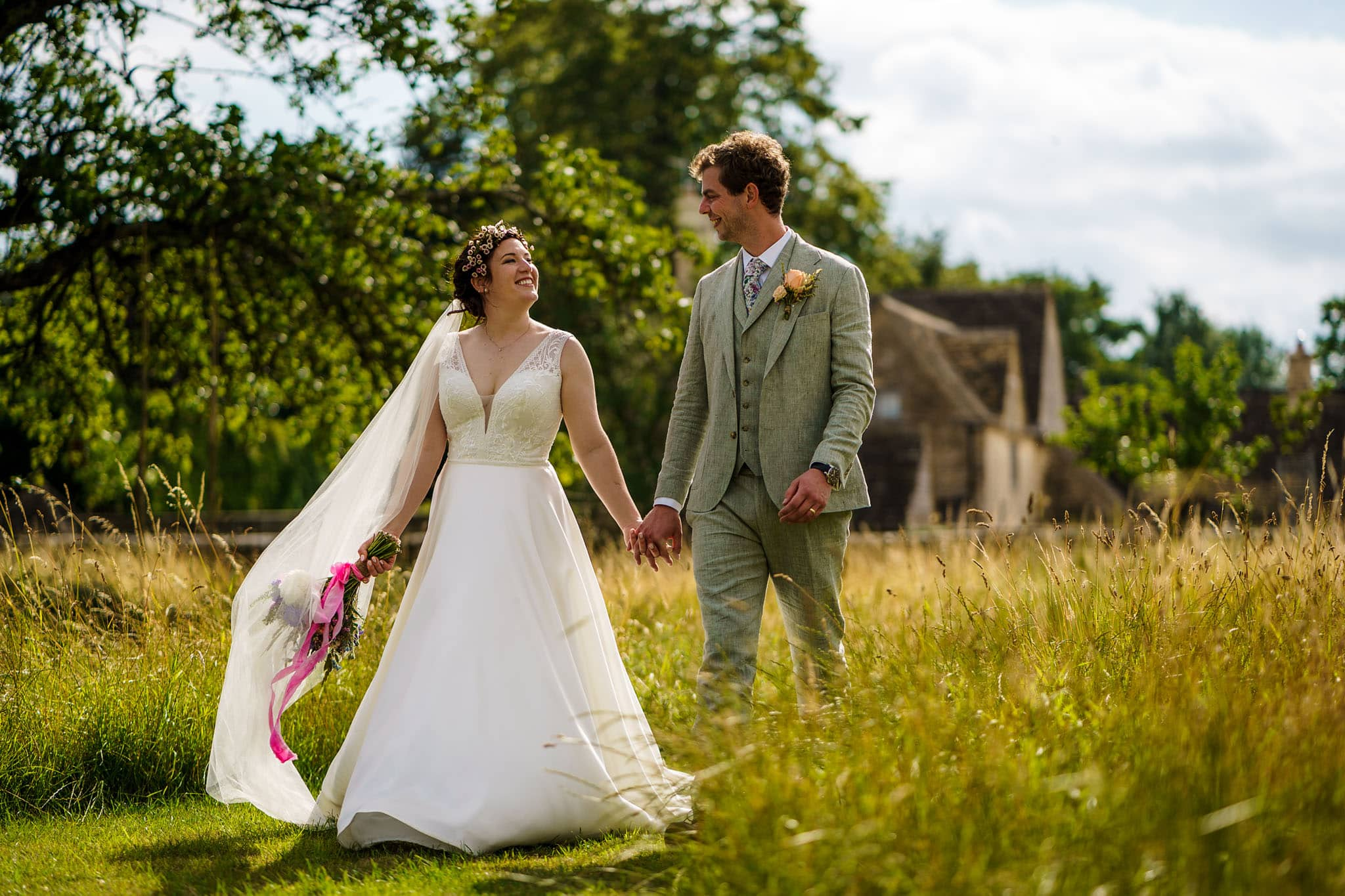 bride and groom walking through the fields at Berry Farm