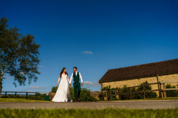 bride and groom walking together on a hot summer day